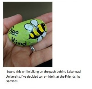 Rock painted with a bee