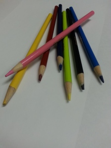 pencil crayons against a white background