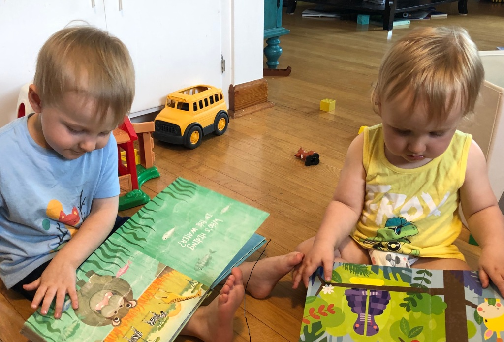 Gavin, right, with one of his favourite reading buddies.
