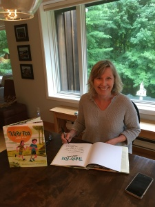 photo of Mary Beth Leatherdale signing copies of Terry Fox and Me